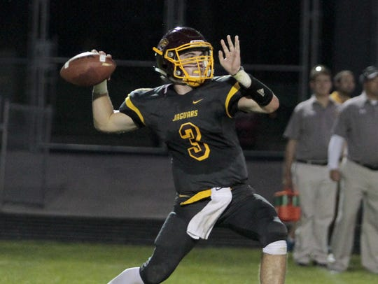 Cooper quarterback Michael Armour airs it out for the Jaguars.
