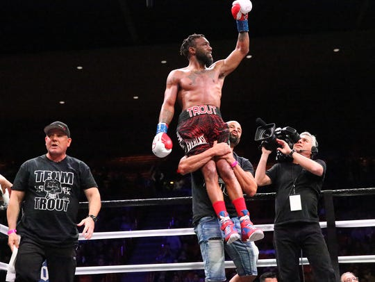 Las Cruces boxer Austin Trout is raised up at the end of his bout with Juan De Angel of Barranquilla, Colombia, in February of 2018  in the Don Haskins Center. Trout won by unanimous decision. Trout's next fight is on May 25 in Biloxi, Miss.
