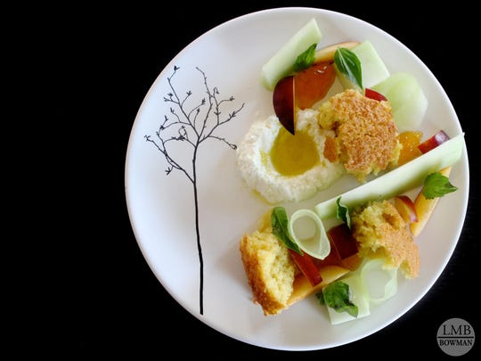 An olive oil cake is served with ricotta, basil, stone fruit and melon.