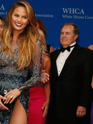 Bill Belichick checks out model Chrissy Teigen at the White House Correspondents  Dinner on Saturday, April 25.