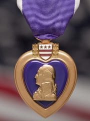 Survivors and the families of those who were killed in the 2009 Fort Hood shooting received Purple Hearts and Defense Medals of Freedom in an April 10, 2015 ceremony in Texas.