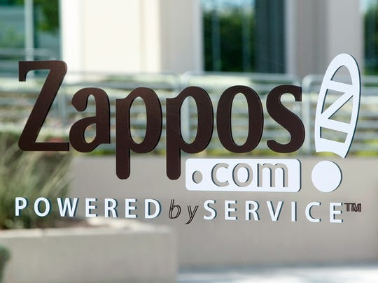 A sign is seen on the front door of the Zappos.com headquarters in Henderson.