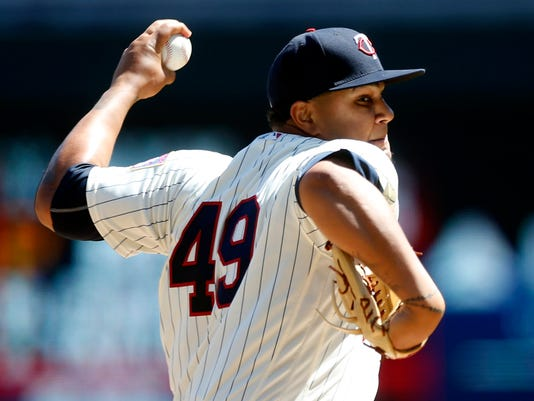 Minnesota Twins pitcher Adalberto Mejia throws against the Detroit Tigers in the first inning of a baseball game Saturday, April 22, 2017, in Minneapolis. (AP Photo/Jim Mone)