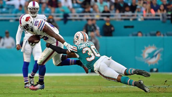 Miami Dolphins cornerback Cordrea Tankersley (30) dives for Buffalo Bills running back LeSean McCoy (25) during the first half at Hard Rock Stadium.