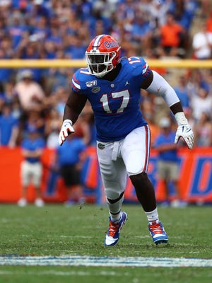 Florida defensive lineman Zachary Carter is poised for a big year on the Gators' defensive front. [USA Today]