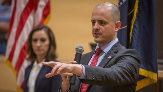 Evan McMullin answer questions from voters at a town hall meeting at the Syracuse City Hall in Syracuse, Utah on Thursday, Oct. 13, 2016. The independent candidate for president also used the event to introduce his running mate, Mindy Finn, at left.