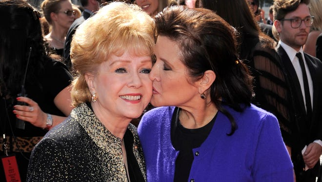 Debbie Reynolds and her daughter Carrie Fisher in September 2011 in Los Angeles at the Emmys.