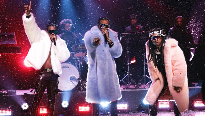 "Migos performing ""T-Shirt"" on ""The Tonight Show Starring Jimmy Fallon"" on March 23, 2017. The hip-hop trio is set to headline Lansing's PRIME Music Festival on September 15."