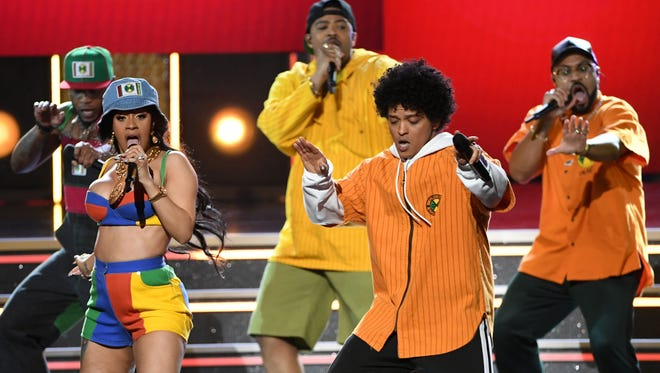 Cardi B (L) and Bruno Mars perform onstage during the 60th Annual GRAMMY Awards at Madison Square Garden on January 28, 2018 in New York City.