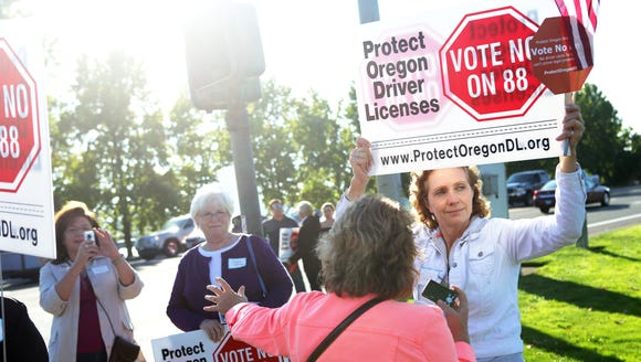 Sheila Rodgers of McMinnville, right, and other protesters