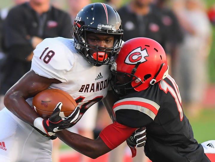 Brandon High School receiver Jonathan Mingo (18) tries