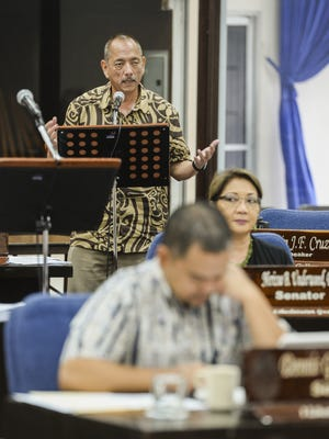 Vice Speaker Benjamin J. Cruz, standing, testifies on Bill 212 as senators meet for session at the Guam Legislature in Hagatna on Friday, Jan. 15. Bill 212, authored by Cruz, is an act to authorize the Attorney General the use of funds for experts in federal litigation case.