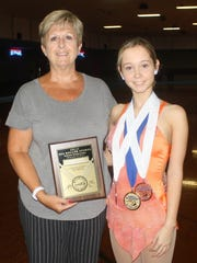 Amanda Smyser is pictured with hall-of-fame coach Vickie