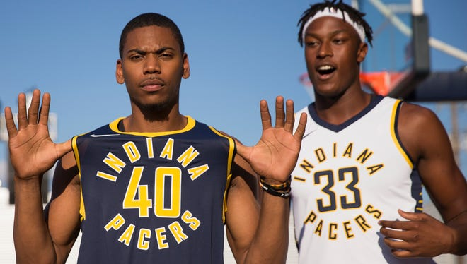 Glenn Robinson III (left), and Myles Turner show off new Pacers uniforms during a team-sponsored block party on the city's west side, Indianapolis, Friday, July 28, 2017.