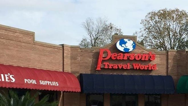 Pearson's Travel World has relocated.