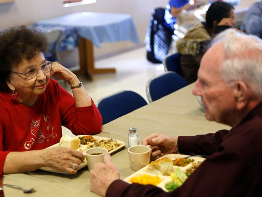 Gale and Wanda Krause share a moment during lunch on Thursday at the Bonnie Dallas Senior Center in Farmington.
