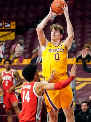Minnesota's Liam Robbins (0) shoots over Ohio State's Justice Sueing (14) during the first half of an NCAA college basketball game Sunday, Jan. 3, 2021, in Minneapolis. (AP Photo/Jim Mone)