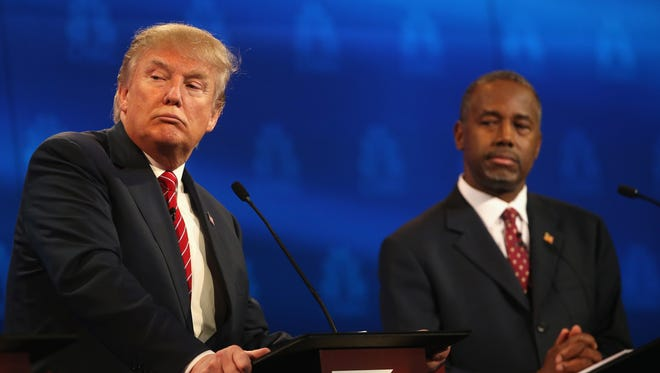 Donald Trump, left, and Ben Carson appear at a Republican Presidential Debate on Oct. 28, 2015, in Boulder, Colo.