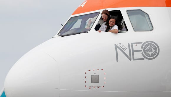 EasyJet pilots pose from the cockpit of the carrier's