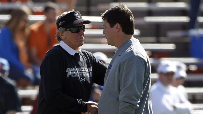 Steve Spurrier's return to Florida should allow Carolina to give its undivided devotion to his successor, Will Muschamp (right).
