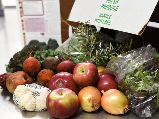 Boxes of farm fresh produce grown by five local farmers