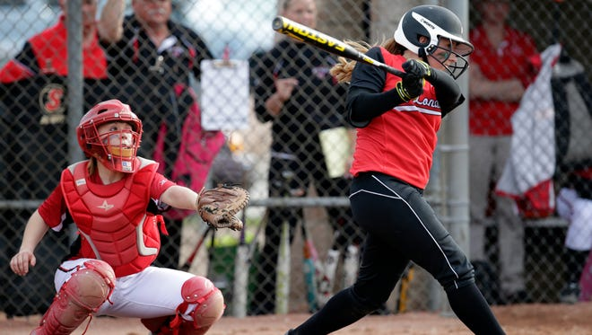 New London's Alanna Beyer (right) drives in a run against Hortonville High School during a Bay Conference softball game May 8, 2014 at Hortonville.