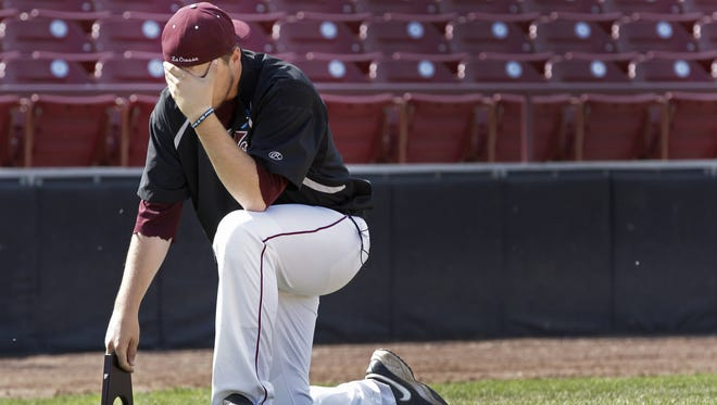 University of Wisconsin-La Crosse's Ben Cejka takes a moment alone after a loss to SUNY-Cortland during final of the NCAA Division III Baseball Championship  Wednesday, May 27, 2015, at Neuroscience Group Field at Fox Cities Stadium in Grand Chute, Wis. SUNY-Cortland won 6-2.