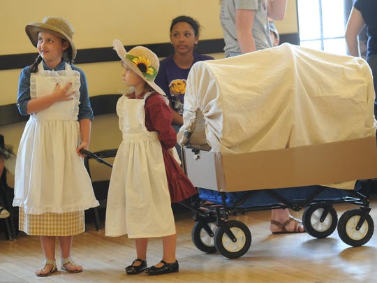 Beth Shirley, left, and her sister, Sarah, compete in the CALF costume contest on June 8, 2017, at the Elks Arts Center. The two Abilene youngsters are dressed as characters from Little House on the Prairie.