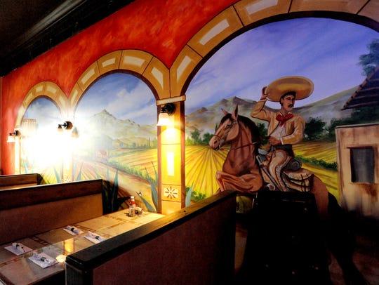 Artwork adorns the walls of Maria's Mexican Restaurant