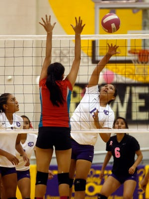 Kirtland Central's Krystal Sheka spikes the ball against Shiprock on Oct. 27 at Bronco Arena in Kirtland.