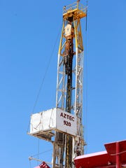 A workover rig sits in the rig yard of Aztec Drilling
