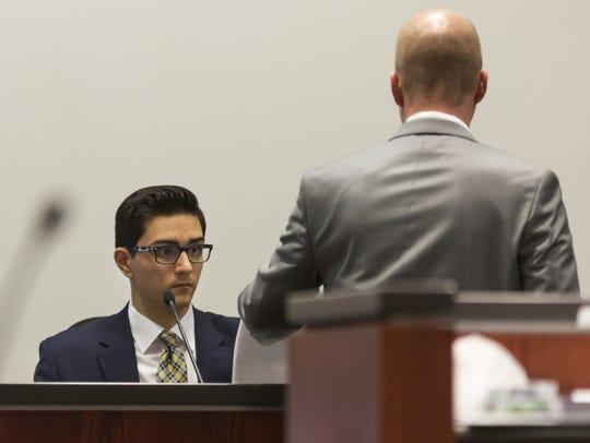 Steven Jones (left) looks at evidence presented by