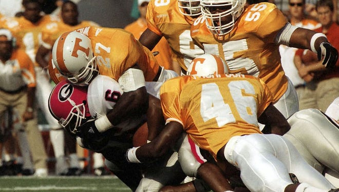Tennessee's Al Wilson takes down Georgia's Patrick Pass on October 11, 1997.