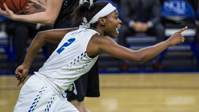 FGCU's Kaneisha Atwater signals after scoring during their first half of the NIT tournament game against Wake Forest at Alico Arena Monday evening.