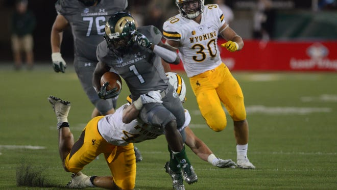 CSU running back Dalyn Dawkins, shown trying to break the tackle of Wyoming's Lucas Wacha during Saturday night's game at Hughes Stadium, said the Rams need some leaders to step up in order to get their season back on track.