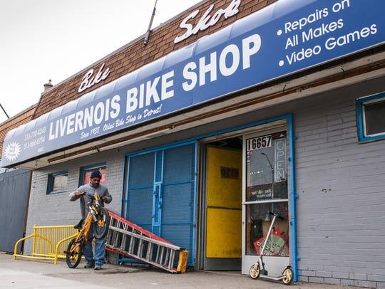 Scott Ford, 52, of Detroit works on a bike outside