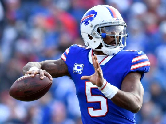 Dec 3, 2017; Orchard Park, NY, USA; Buffalo Bills quarterback Tyrod Taylor (5) throws a pass during the first quarter against the New England Patriots at New Era Field. Mandatory Credit: Mark Konezny-USA TODAY Sports