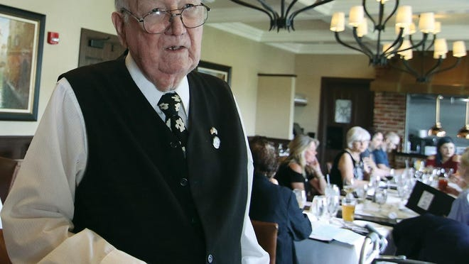 Reflecting on his life and friends and the poetry he has just read to them, James F. Dwyer speaks of his good fortune to be able to share a meal with his friends and family on his 90th birthday at Ken's Steakhouse in June 2018.