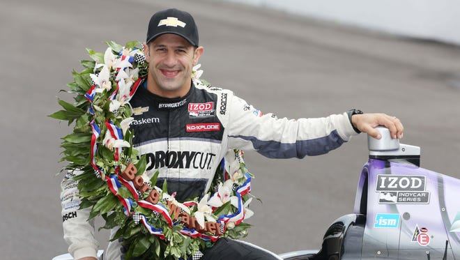 Tony Kanaan, celebrating his victory in the 2013 Indianapolis 500, had a personal contract with Apex-Brasil.