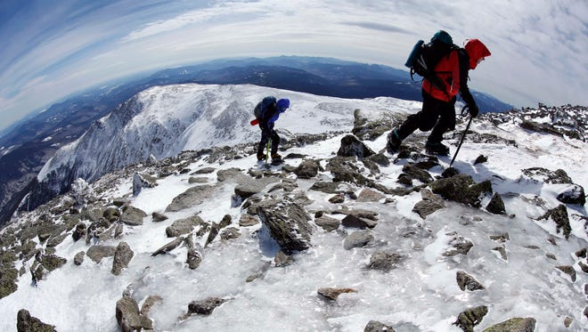 Gary Gustafson, 58, leads Linda Dewey, 54, up an icy trail on the summit cone of Mount Washington in New Hampshire on March 10, 2015.