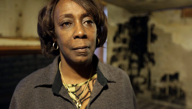 Odessa Willis, 61 in her flooded basement after it was cleaned up with the help of All Hands Volunteers in Detroit.