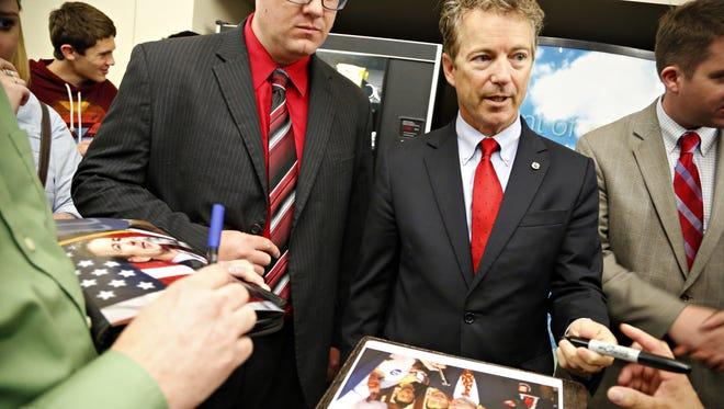U.S. Sen. Rand Paul, R-Ky., signs autographs at the Iowa Faith & Freedom Coalition event Saturday. Senator Rand Paul signs autographs at the Iowa Faith & Freedom Coalition Saturday, April 25, 2015.