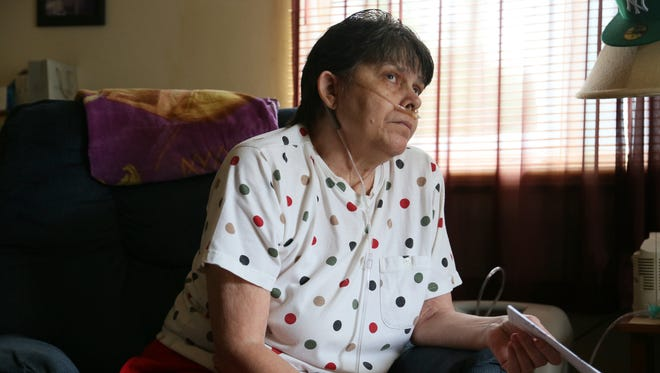 Patricia Guy took out a loan from Western Sky for $2,600 but at an exorbitant interest rate of 139.13% Guy will pay over $11,412 in interest if she keeps paying at this rate. The Free Press visited Guy, who was watching the Price is Right in her Lansing apartment Tuesday Aug. 6, 2013. Mandi Wright/Detroit Free Press