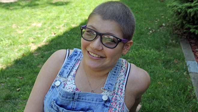 """Adell Cirrincione, 16, was diagnosed with Ewing Sarcoma, a rare type of bone cancer when she was 15. Adell, who is now in remission, was photographed at her home in Congers on May 8, 2015. """"You've got to be thankful for what you've got,"""" she says. """"You can't take anything for granted."""""""