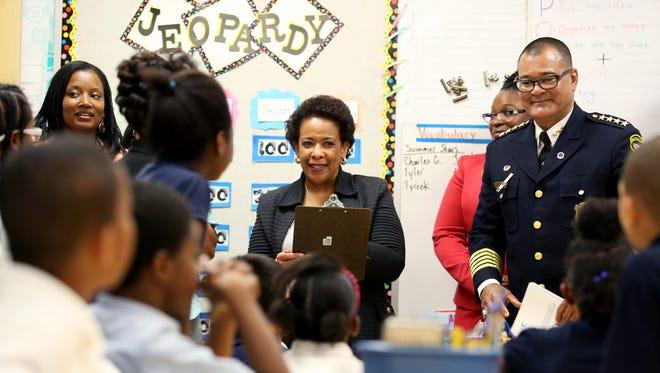 U.S. Attorney General Loretta Lynch (center) and Cincinnati Police Chief Jeffrey Blackwell visit a third-grade class at Chase Elementary School in Northside.