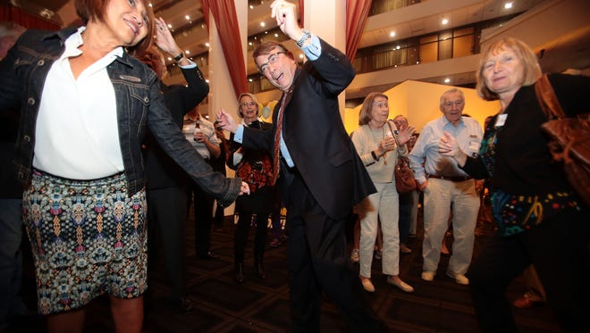 """Palm Springs mayoral candidate Rob Moon dances to """"La Bamba"""" sung by Trini Lopez at his election night party at the Hyatt in Palm Springs on Tuesday."""