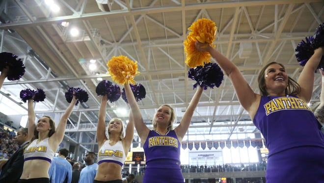 Members of the UNI dance team and cheer squad pump up the crowd during the North Carolina at UNI basketball game on Saturday, Nov. 21, 2015, in the McLeod Center.