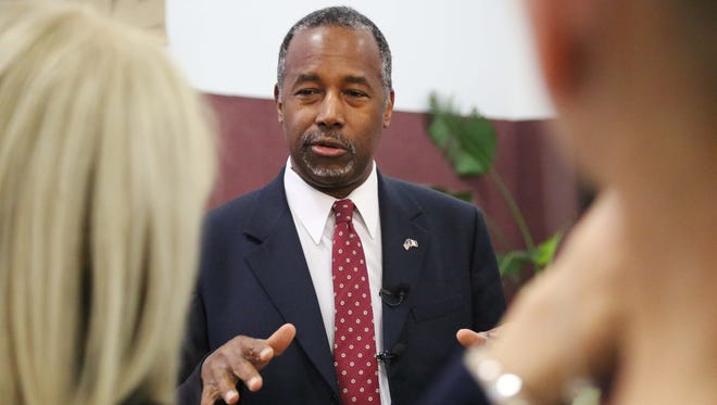 Presidential hopeful, Ben Carson answers a few questions from the press while meeting with parishioners at Corinthian Baptist Church on Sunday, Jan. 10, 2016, in Des Moines. Carson shook hands, posed for photos and spoke briefly during worship services.