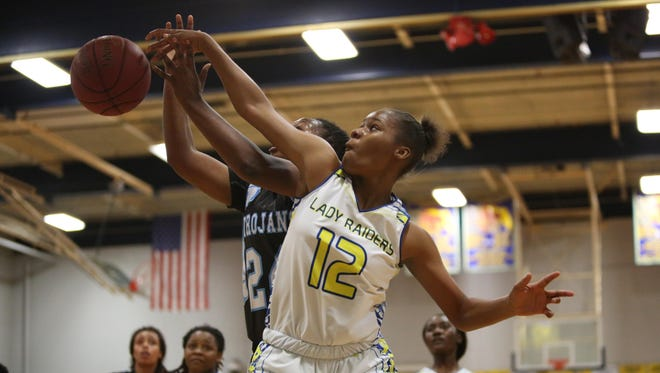 Rickards sophomore Tamia Riles blocks the shot of Jacksonville Ribault's Day'Neshia Banks during Friday's Region 1-5A final. State No. 1 Ribault ended the Raiders' season with a 68-32 win.