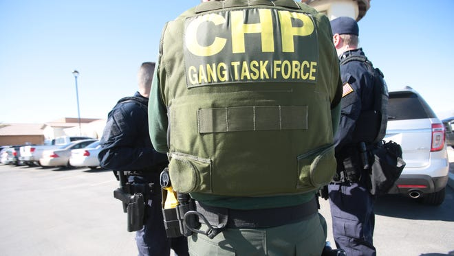 A CHP Gang Task Force officer unloads at the Thermal sheriff's station Thursday, Feb. 25, 2016.
